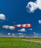 Windsock on the dark blue sky Stock Images