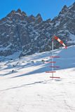 Windsock at helicopter landing. Windsock and snow level meter at helicopter landing area high in snowy mountains. French Alps. Chamonix Royalty Free Stock Image