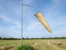 Windsock and Light Aircraft Runway. Windsock with light aircraft runway and clear blue sky in the background Royalty Free Stock Photo