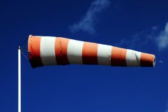 Windsock and moon. Windsock on blue sky and moon in the background Royalty Free Stock Photography