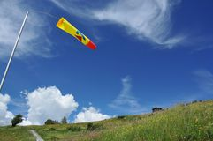 Windsock and mountain meadow Stock Photo