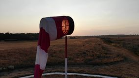 Windsock in no windy sunset. Camera moving from bottom to top stock footage