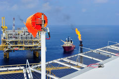 The windsock at the offshore oil and gas platform Stock Photos