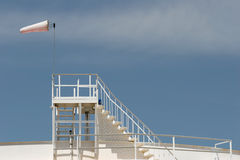 Windsock on oil storage tank. Oil storage tank with windsock Royalty Free Stock Photos
