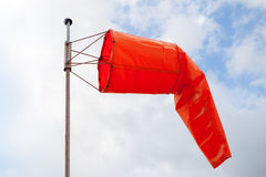 Windsock. Red wind indicator over cloudy sky Royalty Free Stock Photo
