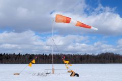 Windsock is on the snowy field. stock photography