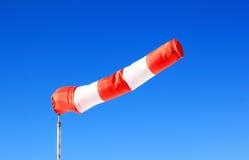 Windsock vermelho na frente do céu azul profundo Fotografia de Stock Royalty Free