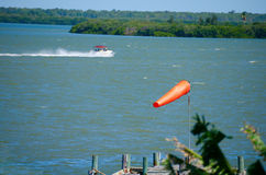 Windsock weather sock with wind and boat Stock Images