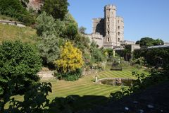 Windsor Castle garden and fountain on a cloudless summer day. royalty free stock image