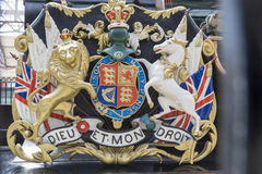 Windsor Castle. Lion and unicorn on English heraldic coat of arms on an ancient steam train in Windsor Royalty Free Stock Images