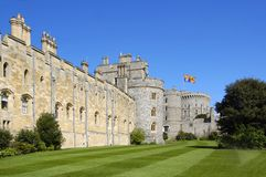 Windsor Castle With The Royal Standard Flag Flying. Windsor castle with the United Kingdom Royal Standard flag flying, which indicates that the royal family are Royalty Free Stock Photos