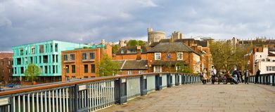 Windsor, England. Bridge over River Thames connecting Windsor and Eton with Windsor Castle in the background stock image