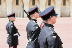 Changing guards with soldiers armed with rifles in Windsor Castle. WINDSOR, ENGLAND - JUNE 09, 2017: Changing guard ceremony with soldiers armed with rifles and royalty free stock images