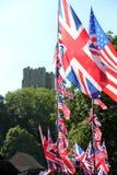 Windsor, Uk, 5/19/2018 : British and American flags outside Windsor castle for wedding of Meghan Markle and Prince Harry. Windsor, Uk, 5/19/2018 : British & Stock Photo