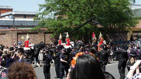 Silhouettes of Royal Guards march street. WINDSOR, UNITED KINGDOM - MAY 19, 2018: Silhouettes of Royal Guards march in street on horses around Windsor Castle stock video