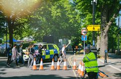 Royal wedding sign and tours group. WINDSOR, UNITED KINGDOM - MAY 19, 2018: Tours group and Royal Wedding yellow street sign arrow during marriage of Prince Stock Photo