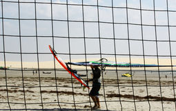 Windsufer through volleyball net Royalty Free Stock Image
