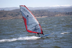 Windsurf. SAN LUIS - ARGENTINA - JULIO 24: A young person practices windsurf in the lake of the dock Florida in Argentinean the 24 of Julio of 2011 stock photography