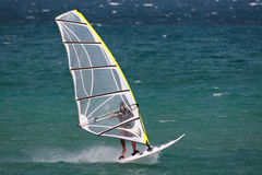 Windsurf in the beach. A man is doing windsurf in the sea stock photo