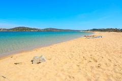 Windsurf board on a golden shore. Windsurf board on the sand in Porto Pollo, Sardinia Royalty Free Stock Photo