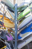 Windsurf boards background. Closeup of windsurf boards on a rack useful as a background - focus on the center of the image royalty free stock image