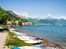 Windsurf boards deposited on the beach. Pianello del Lario, Italy - May 16, 2015: Windsurf boards deposited on the beach by the lake, waiting to be used Stock Photography
