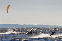 Windsurf competition. In wild wind on wavy water Royalty Free Stock Photos