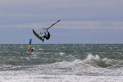 Windsurf free style. Windsurf acrobatic jump in the sea stock photos