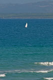 Windsurf in the Mediterranean sea. With blue water and waves in foreground royalty free stock photography