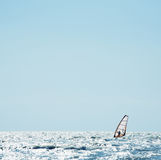 Windsurf sail on the sea. Against blue sky stock image