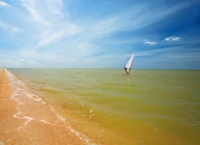 Windsurf sail on the sea. Against blue sky stock photos