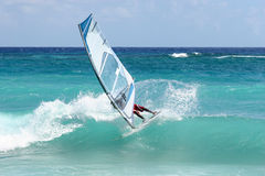 Windsurf snap. Windsurfer snaps on a small clean wave royalty free stock photo