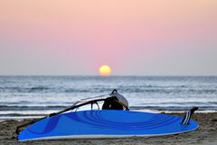 Windsurf at sunset. Winsurf board layng in the beach at sunset time Stock Photos