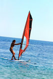 Windsurf - surfer girl. On blue sea surface royalty free stock images
