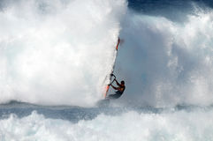 Windsurfer. A windsurfer in the waves of the ocean Stock Photos
