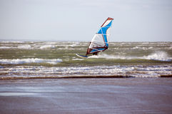 Windsurfer. A wind surfer making full use of the wind on a wenglish winters day Stock Photos