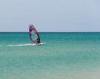 Windsurfer. One windsurfer in a turquoise beach Royalty Free Stock Photography