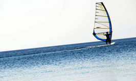 Windsurfer. Perfect stance for this speeding-up windsurfer silhouette Royalty Free Stock Image