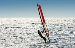 Windsurfer. Playing on the beach royalty free stock images