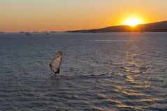 Windsurfer against the setting sun in Gelendzhik Bay Stock Image