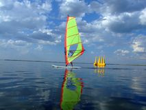 Windsurfer And Its Reflection Royalty Free Stock Photography