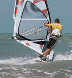 Windsurfer by back Royalty Free Stock Photo