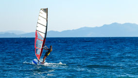 Windsurfer in background of mountains in the distance. summer Sunny day. Greece, Rhodes royalty free stock image