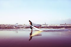 Windsurfer on the beach in Holland stock images