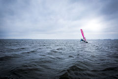 Windsurfer on a big lake Royalty Free Stock Photos