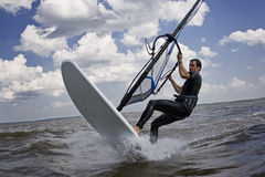 Windsurfer breaking. Windsurfer doing a breaking trick in the water Stock Photos