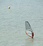 Windsurfer and buoy Stock Photography