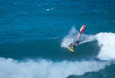 Windsurfer compeeting at Hookipa beach Maui. Windsurfer shredding at the Maui Makani Classic windsurfing competition. Hookipa beach Maui. October 31 2014 Stock Image