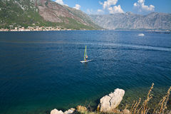 Windsurfer crosses the Bay of Kotor Stock Images