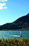 Windsurfer exercising on lake Como in windy sunny day. Stock Photo
